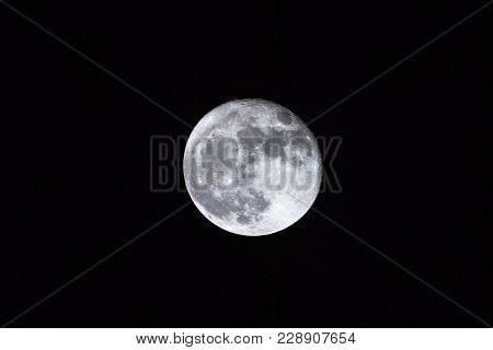 Full Moon Over Dark Black Sky Background At Night. Lunar Perigee Super Moon Coincidence Of A Full Mo