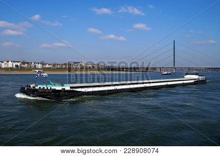 Düsseldorf, Germany - February 28, 2018: Dutch Inland Waterway Motor Freighter Adriaan Pieter On The