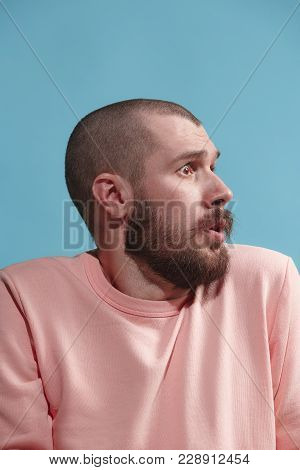 Young Casual Man Is Afraid. Emotional Man Is Afraid On Pastel Studio Background. Male Profile, Three