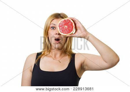 Young Cheerful European Woman With Blond Hair And Big Grapefruit Eyes. Healthy Eating, Raw Food Conc