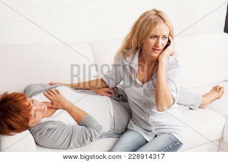 Female calling 911. Cardiac pain