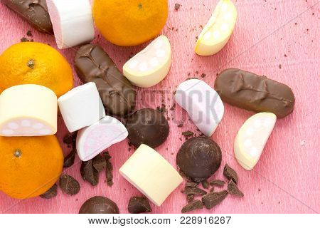 Oranges, Chocolate And Zephyr On Pink Background, Top View. Process Of Cooking Of Homemade Sweets Co