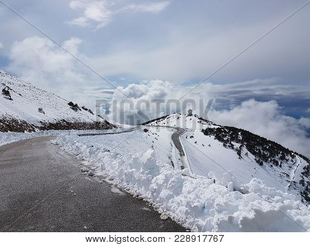 Hight Asphalt Road Of The Snow-covered Mountain Vanteau In The South Of France. Snow-covered Summit.