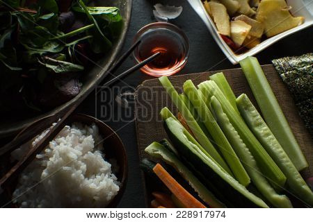 Chopsticks, Rice And Ingredients For Making Sushi Are A Top View. Asian Cuisine Horizontal