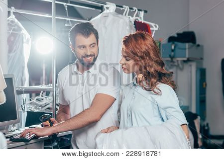 Dry Cleaning Workers Using Computer And Barcode Scanner