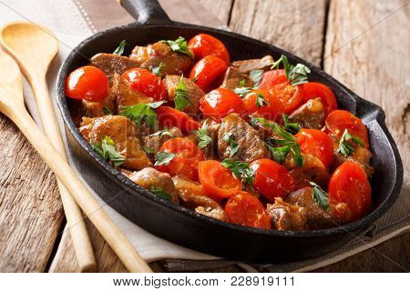 Organic Food: Beef In Spicy Sauce With Tomatoes And Greens Close-up On A Frying Pan. Horizontal