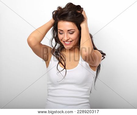 Beautiful Positive Excited Laughing Young Woman Holding The Hands The Hair On The Head In White Shir