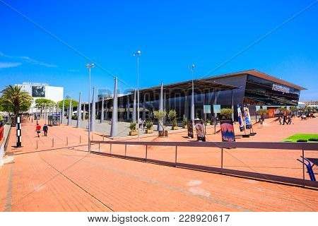 Barcelona, Spain - May 27, 2016: Pedestrian Zone With Art Objects Of Shopping And Entertainment Cent