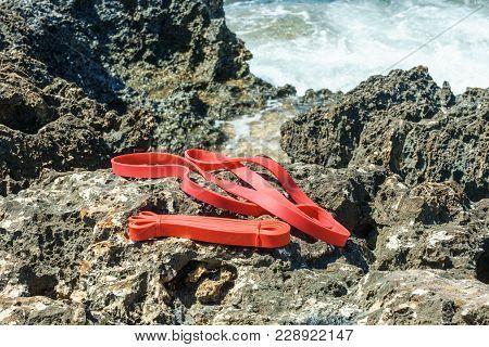 Expander On The Stony Seashore. Close Up