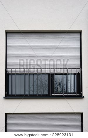The Modern Facade Of A Modern Residential Building A Window With Metal Blind.