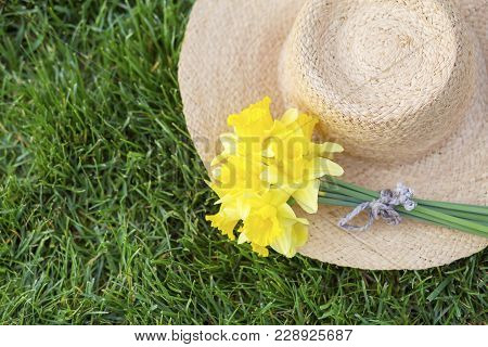 Easter Yellow Daffodil Flower On A Straw Hat In Spring
