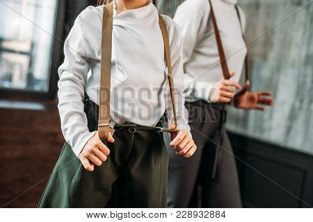 Cropped Shot Of Mother And Daughter In Stylish Clothing With Suspenders