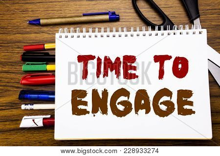 Word, writing Time To Engage. Business concept for Engagement Involvement Written on notebook, wooden background office equipment like pens scissors colourful marker poster