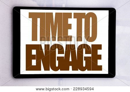 Hand Writing Text Caption Inspiration Showing Time To Engage. Business Concept For Engagement Involv