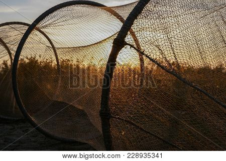 Fishing Nets Drying In The Light Of The Setting Sun