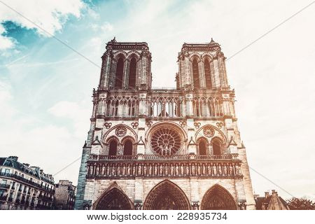 Front view of Notre-Dame Cathedral against sunny sky, Paris, France