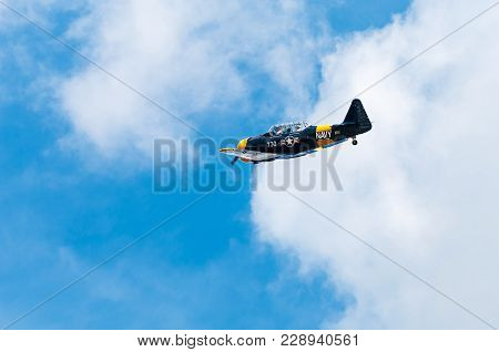 Eden Prairie, Mn - July 16, 2016: At-6 Texan Flies By At Air Show. The At-6 Texan Was Primarily Used