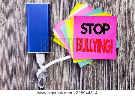 Stop Bullying. Business concept for Prevention Problem Bully written on sticky note with space on old wood wooden background with power bank poster
