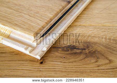 Brown Wooden Parquet Floor Planks Installation , Close Up. Carpentry Concept.