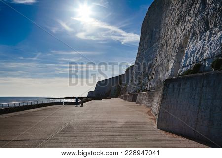 Undercliff Walk path for walkers and cyclists at the foot of protected white chalk cliffs near Brighton in East Sussex on the south coast of England, UK