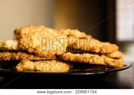 Tasty Glossy Brown Homemade Oatmeal Cookies On Black Plate, Side View. Delicious Peanut Oatcakes, He