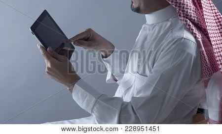 Saudi Arabian Man Hands Holding Tablet