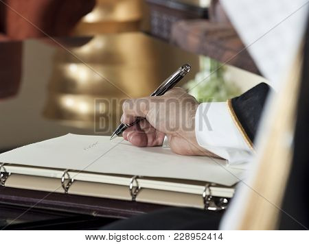 Saudi Arabian Man Hand Writing On A Notebook