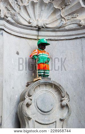Brussels, Belgium - April 22, 2017: Manneken Pis - Little Man Pee Or Le Petit Julien, A Landmark Sma