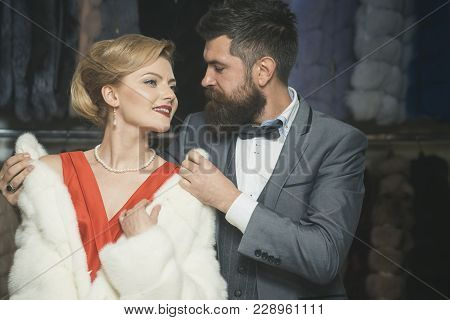 Woman In Fur Coat With Man, Shopping, Seller And Customer. Date, Couple, Love, Man And Woman. Busine