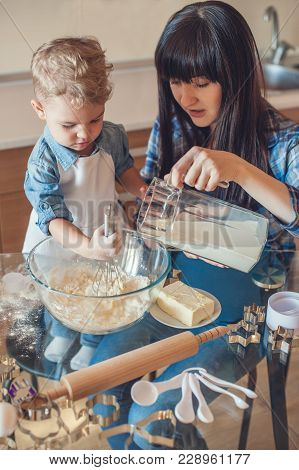 Son Whisking Dough And Mother Pouring Milk