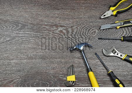 Tools On A Wooden Background With Copy Space.