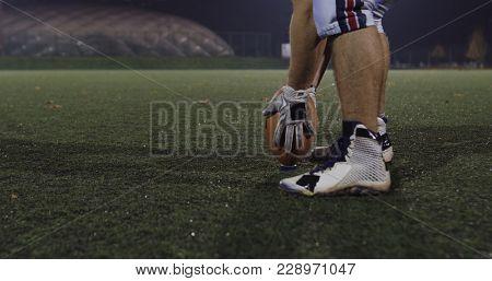 american football kicker ready for football kickoff closeup shot on the night field