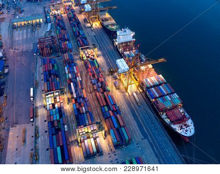 Container In Import/export And Business Logistics,by Crane,trade Port,shipping Cargo To Harbor,aeria
