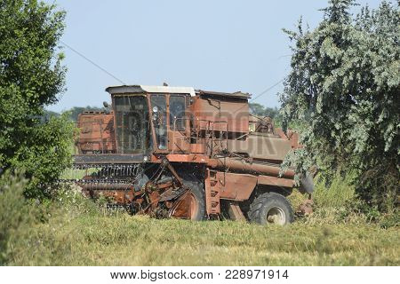 Old Rusty Combine Harvester. Combine Harvesters Agricultural Machinery. The Machine For Harvesting G