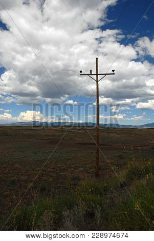 Power Lines In The Middle Of Nowhere Sending Electricity To Remote Locations.
