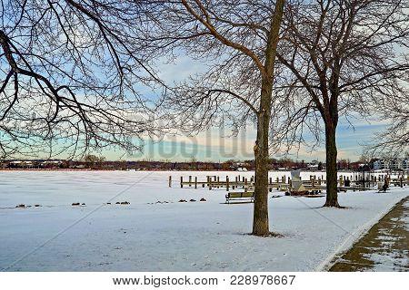 Winter Sunset At Excelsior Bay Harbor In Minnesota