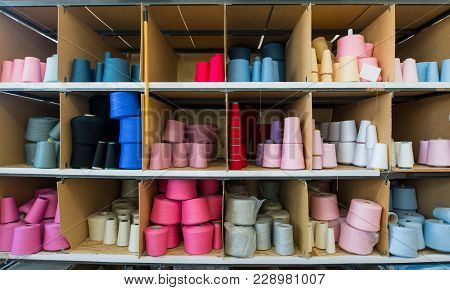 Spools With Different Color Thread On Shelves At Knitting Factory Shot
