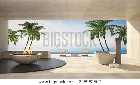 Open air patio in a luxury tropical villa overlooking the sea with palm trees and feature burning flame. 3d rendering