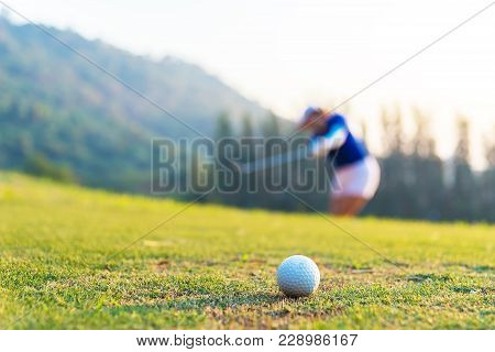 Golf Ball And Tee On Green Grass Background.golfers Hit Sweeping And Keep Golf Course In The Summer