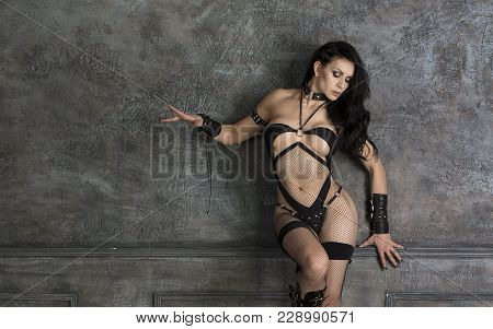 Sensual, Beautiful And Attractive Young Woman With Seductive Slim Body Large Bust Size Is Posing On