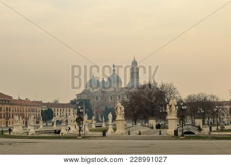 Padua, Italy - January 25, 2018: Prato Della Valle With Basilica Of St Giustina In The Light Haze On