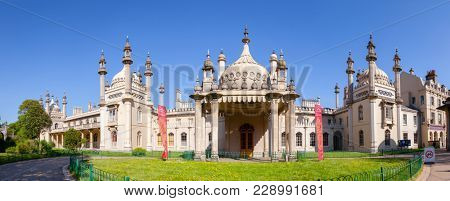BRIGHTON, UK - JUN 5, 2013: Panoramic view of the Royal Pavilion (Brighton Pavilion), former royal residence built in the Indo-Saracenic style pictured from the Pavilion Gardens