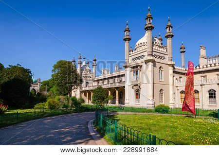 BRIGHTON, UK - JUN 5, 2013:View of the Royal Pavilion (Brighton Pavilion), former royal residence built in the Indo-Saracenic style pictured from the Pavilion Gardens