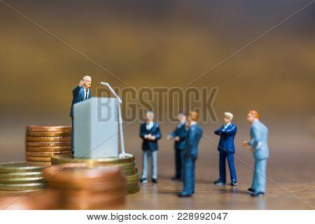 Miniature People : Businessman Speaking On The Podium