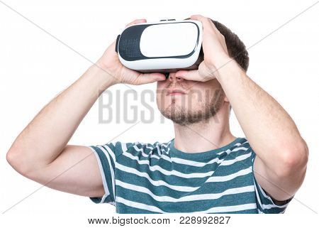 Man wearing virtual reality goggles watching movies or playing video games - closeup. Male looking in VR glasses, isolated on white background.