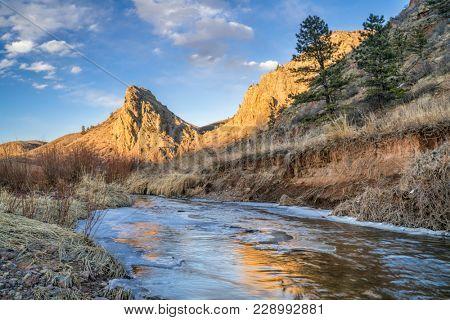Eagle Nest Rock and partially frozen North Fork of Cache la Poudre River in northern Colorado at Livermore near Fort Collins, winter