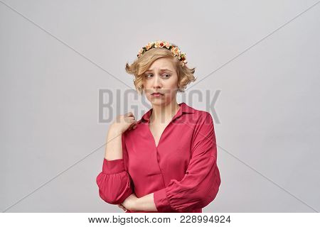 Portrait Of Young Stylish Girl In Festive Clothing With Sad Eyes And Confused The Bored Expression O