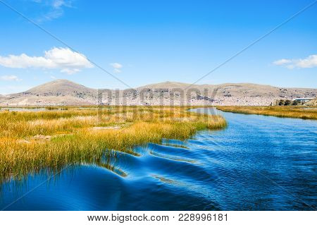 Titicaca Is A Large, Deep Lake In The Andes On The Border Of Peru And Bolivia