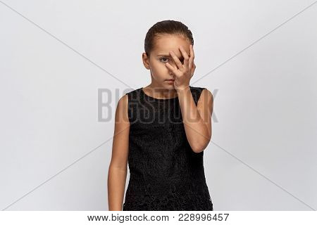 Beautiful Portrait Of A Bored Girl, Half Face Closed By The Palm. Girl With Black Hair Tired Of Anno