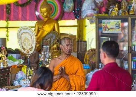 KOH CHANG, THAILAND - MAR 1, 2018: Monk during celebration of Makha Bucha Day. One of the three most important holidays of Buddhism, which dictates its social norms to locals and foreign tourists.